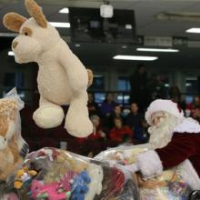 Santa catching a stuffed bear for CHEO