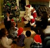 Santa having a chat with his young friends.