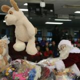 Santa catching a stuffed bear for CHEO